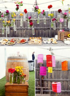 Love the hanging bottles with flowers.