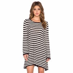 Free people dress Free people stripped swing tunic in ivory and black. Fits a s m and large as well Free People Dresses