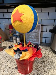Toy Story main table centerpiece idea - Toy Story Birthday party centerpiece idea- used a styrofoam, wood stake and painted it with ye - Toy Story Centerpieces, Toy Story Decorations, Birthday Party Centerpieces, Birthday Party Tables, 4th Birthday Parties, Birthday Ideas, Elegant Centerpieces, Rustic Centerpieces, Shower Centerpieces