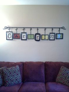 Dollar store picture frames, spray paint, curtain rod, ribbon and eye hooks.