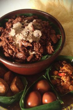 GUDEG. ( is a sweet young jackfruit dish usually served with rice, egg, chicken, Tofu and Tempeh sambal and crunchy beef skin (Krecek), Traditional food from Yogyakarta, Indonesia ).