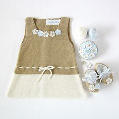 Knitted baby dress in camel and pearl with little flowers , matching shoes. 100% cotton. $85.00, via Etsy.