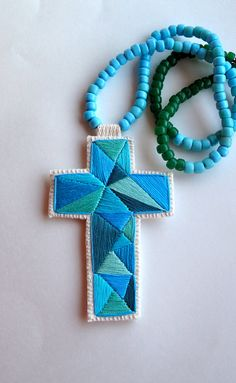 Hey, I found this really awesome Etsy listing at http://www.etsy.com/listing/123116490/embroidered-cross-necklace-geometric