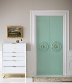 Closet door diy with ceiling medallions + paint.