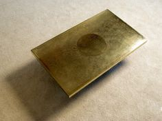 Signed Ricco D etched brass coffee table 1970. Modern online gallery. Featuring a varied selection of vintage furniture and architect furniture. At http://www.furniture-love.com/vintage/furniture/