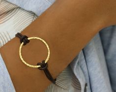 Leather and hammered gold bracelet-saw one up north that cost more and was not as nice.