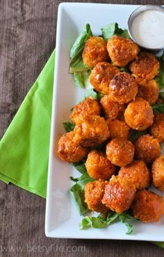 Buffalo Quinoa Bites are easy to make and a crowd-pleasing appetizer to serve at your next laid back get-together with pals! Serve with blue cheese or ranch dressing as a cool and crisp counterpart to the delicious buffalo spice!