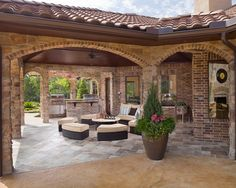 Outdoor kitchen-love the arches and the combo of stone with brick