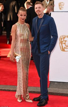 Fashion forward: Millie Mackintosh looked like an award herself in her gold knitted outfit while husband Professor Green stuck to black and blue