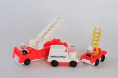 Vintage Fisher Price Toy from the Little People series.  #928 Play Family Fire Station 1980-1982, Made in U.S.A.  Includes:  1 Big Red fire truck with a white 2-piece ladder (missing 1 section). 1 Small Red (bright red) fire truck with a yellow ladder 1 Ambulance  3 originals Little