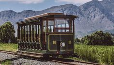 Hop-on Hop-off Experience The Franschhoek Wine Tram hop-on hop-off tour is one of the best ways to discover the true essence of the Franschhoek Valley – picturesque vineyards, breath-taking scenery, warm hospitality, world-class cuisine, fine wines and a 300 year history.Passengers aboard the hop-on hop-off tour will