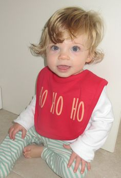 Get in the christmas spirit with this subtle but cute hand screen printed dribble bib in festive red with gold writing. printed with EVO eco inksheat sealed and machine washablesuitable from months Handmade Baby Gifts, New Baby Gifts, Congratulations Gift, Dribble Bibs, Organic Baby Clothes, Newborn Baby Gifts, Evo, Baby Shower Gifts, Screen Printing