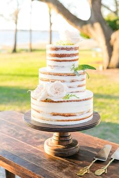 Jenn & Tyler's Naked Wedding Cake made by PPHG Pastry Chef Jessica Grossman | Destination wedding at The Lowndes Grove Plantation in Charleston, SC | Featured on The Wedding Row | Photo by Dana Cubbage Weddings