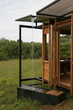writer builds a tiny office and makes a water fountain so she hears rain all the time.