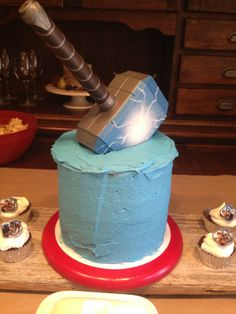 Thor Cake - Mjölnir ~ AVENGERS - Birthday Cake          Visit www.fireblossomcandle.com for more party ideas!