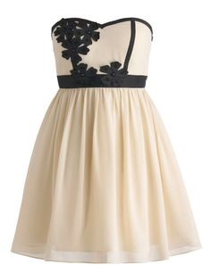 Floral Artistry Dress: Features a chic strapless cut and padded bust for full support, contrast black floral appliques blooming atop the bodice, banded empire waist for a figure-flattering effect, and a twirl-worthy gathered chiffon skirt to finish.