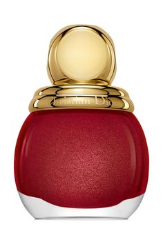 Dior Diorific Vernis Nail Polish in Splendor: Red is a signature nail color during the winter season (and, like, all the time) no matter what you're celebrating. Dior's festive shade will give you all the holly, jolly feels and then some, with minuscule flecks of gold for subtle enhancement.