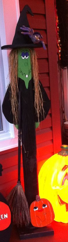 Witch made from landscape timber and painted for Halloween