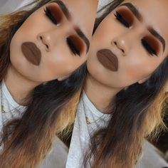 Autumn inspired makeup look full of burgundy red makeup forever eyeshadow tones perfect for fall black eyeliner, And a nice bold lip.
