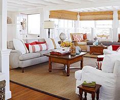 Cozy beach cottage - white slipcovers on sofa, sea grass wingback chair, jute rug