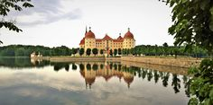 Moritzburg castle's reflection in the lake that surround the castle, Germany.