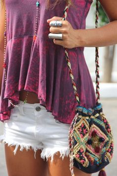 purple tie dye top, white cut offs and tapestry cross body bag