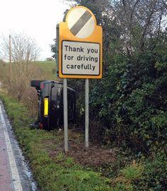 ironic sign car crash