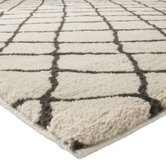 Rug in the living room?  Rugs define spaces. Threshold™ Criss Cross Fleece Rug - Gray