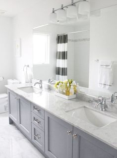 Cool Light Grey Bathroom with a yellow accent