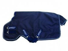 """Horseware Ireland Amigo Bravo 12 Turnout Lite with Leg Arches Navy and White 6'3"""" . $138.00. This wind and waterproof turnout rug is fully breathable and will keep your horse dry, warm and comfortable.  The tough exterior is made of 1200 denier polyester with an inner nylon lining.  The classic Euro-Cut, straight front closures and no-slip design with two criss-cross belly surcingles and tail strap keep this stylish turnout in place.  Horseware's patented ..."""