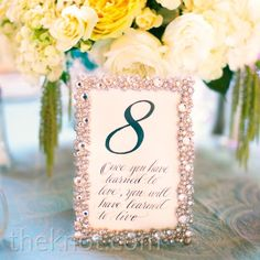 Use table setting cards with quotes from famous mississippi writers glam silver frames drew attention to the table numbers which each featured a quote related junglespirit Choice Image