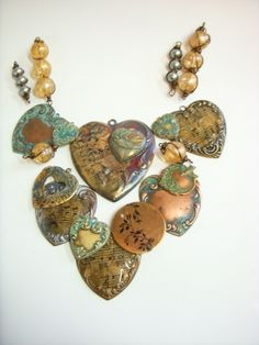Patina and decoupage hearts, stamped ink blanks and art charms made by B'sue.   We have everything you need to make them, too....at http://www.bsueboutiques.com  I use Swellegant patinas as well as Vintaj Weathered Copper inks to create the patina effects.