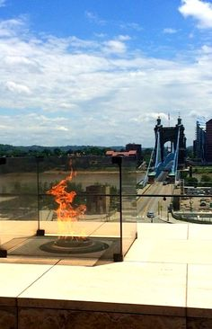 #Cincinnati | Roebling Bridge and National Underground Railroad Freedom Center - Eternal Flame of #Freedom | #EndSlaveryNow Eternal Flame, Underground Railroad, Cincinnati, This Is Us, Bridge, Freedom, Around The Worlds, Outdoor Decor, Liberty