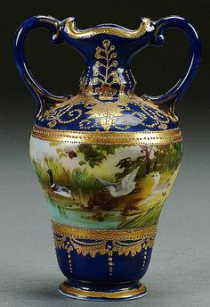 A NIPPON COBALT DECORATED HANDLED PORCELAIN VASE CIRCA 1900 WITH HAND PAINTED WATERFOWL SCENE