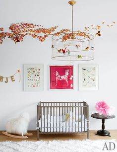 In the nursery, whimsical prints of insects and birds flank a framed Hermès scarf | archdigest.com