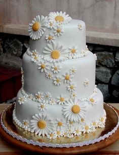 Delightful three tier round white wedding cake covered with small and large intricate white hand made fondant dasies with a yellow centre. From sweetobsessions www.flickr.com                           ........   #wedding #cake #birthday