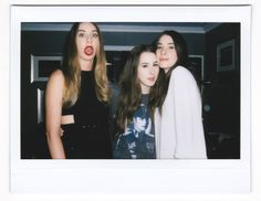 See more photos like this candid Haim shot from the Music Issue party
