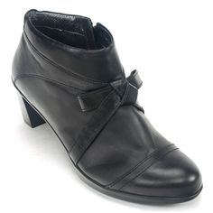 The Naot Vistoso is a fashionable women's ankle boot that features premium leather construction with knotted strap detailing across the vamp. The Vistoso has an easy-on side zipper, and the padded upp