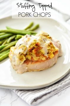 Stuffing-Topped Pork Chops are tender, flavorful chops with savory pork stuffing and creamy gravy on top. It hardly takes any time to prepare this incredible dinner recipe! I made these yummy Stuffing-Topped Pork Pork Chop Recipes, Meat Recipes, Chicken Recipes, Cooking Recipes, Recipies, Cooking Hacks, Cooking Oil, Sweets Recipes, Cooking Ideas
