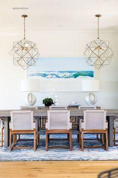 lighting BECKI OWENS- Estillo Project Dining Room - modern coastal dining with woven chairs, geometric brass pendants, and blue Eskayal rug. BM Swiss Coffee and hand scraped oak floors Desert Haze by Provenza. Modern Coastal, Coastal Decor, Coastal Farmhouse, Coastal Style, Coastal Country, Coastal Curtains, Coastal Furniture, Coastal Cottage, Modern Beach Decor