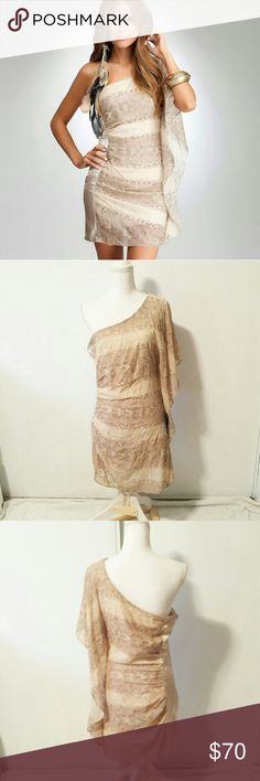"""Nwt Bebe one shoulder drama sleeve tan dress BRAND: Bebe  SIZE: M  FLAW: none  COLOR: beige, tan, cream  DESCRIPTION: Nwt Bebe one shoulder drama sleeve tan dress. Has an almost snake skin print. Gorgeous statement dress. The dramatic sleeve flutters along the side. 100% silk. Retails $140  The mannequin measurements are:  Shoulders: 15"""" Chest: 34"""" Waist: 26.7"""" Hip: 35.4""""  Use #bishoujo to sort for your size. Please note I do have several pets, but most items will be washed before shipping…"""