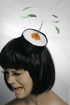 Every woman needs a sushi hat.