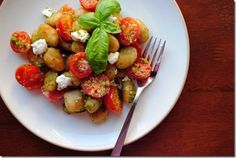 Store-bought gnocchi is sauteed in a skillet until crisp, rather than being boiled, in Crispy Pesto Gnocchi with Tomatoes and Goat Cheese. This meal is fast and absolutely fabulous! | iowagirleats.com