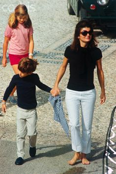 Jacqueline Bouvier-Kennedy-Onassis with her children John and Caroline.