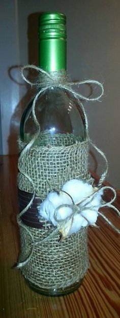 Decorative wine bottle wrapped in burlap and by AllKindsOfDesigns, $15.00