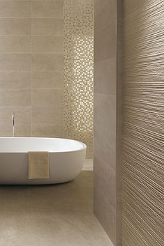 Minimalist bathroom design with textured walls from FCP Ceramics - great matching of colour & texture