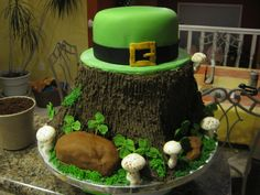 I copied this cake off of Brooklyn cakes website. It is a tree stump cake with a leprechaun hat , with moss, rocks, and mushrooms.