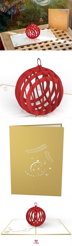 A glittering gold paper art holiday pop up card opens to unveil a red ornament just begging to be hung on your Christmas Tree. #MerryChristmas #HappyHolidays