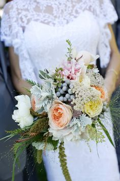 The original pin was intended to show off the bouquet, which is lovely, but I'm crushing on the dress.