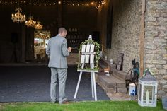 Image by Isabel Maria - Rustic Marquee Wedding In The South West At Court Farm Near Bath With Bride In Charlie Brear Gown From The Decades Collection And Groom In Navy Reiss Suit
